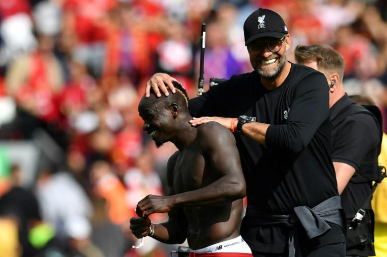 Liverpool manager Jurgen Klopp congratulates Sadio Mane after his two goals against Newcastle at Anfield (AFP Photo/Paul ELLIS)