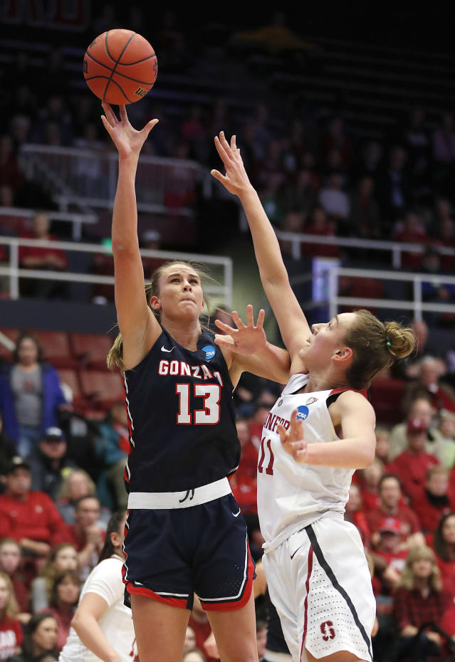 Gonzaga forward Jill Barta (13) takes a shot over Stanford forward Alanna Smith, right, during the first half of a first-round game in the NCAA women's college basketball tournament in Stanford, Calif., Saturday, March 17, 2018. (AP Photo/Tony Avelar)