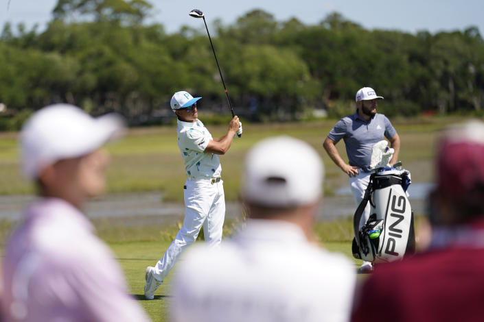 Rickie Fowler watches his tee shot on the third hole during the first round of the PGA Championship golf tournament on the Ocean Course Thursday, May 20, 2021, in Kiawah Island, S.C. (AP Photo/David J. Phillip)