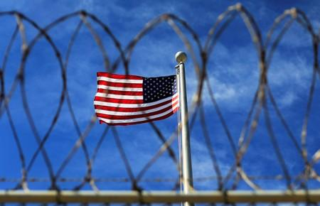 FILE PHOTO: The U.S. flag flies over Camp VI, a prison used to house detainees at the U.S. Naval Base at Guantanamo Bay