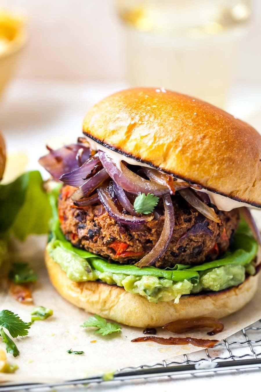 "<p>Jam-packed with peppers, onions, adobe sauce, and spices, these black bean patties are the vegetarian dinner option you've been wishing for. Don't be shy when adding the spicy chipotle sauce. . . it's <i>really</i> good.</p> <p><strong>Get the recipe</strong>: <a href=""https://dishingouthealth.com/chipotle-black-bean-burgers/"" class=""link rapid-noclick-resp"" rel=""nofollow noopener"" target=""_blank"" data-ylk=""slk:chipotle black bean burgers"">chipotle black bean burgers</a></p>"