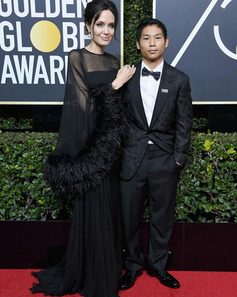 Angelina Jolie walked the red carpet with her son Pax Jolie-Pitt, but Jennifer Aniston skipped the red carpet. Source: Getty