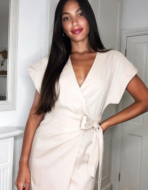 <p>This long <span>ASOS Linen Wrap Midi Dress</span> ($56) is gorgeous.</p>