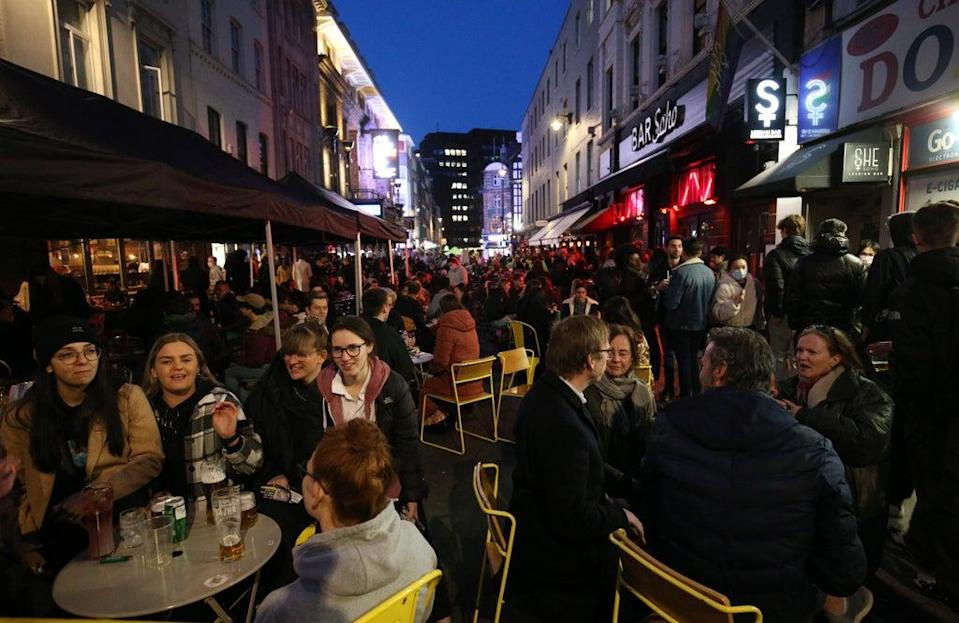 People gather for drinks and food in Old Compton Street, Soho, central London (Jonathan Brady/PA) (PA Wire)