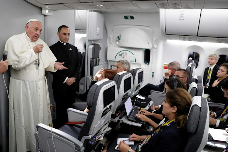 Pope Francis talks to journalists during a press conference aboard a plane to Rome at the end of his visit to Colombia September 11, 2017.