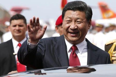 China's President Xi Jinping waves to the media after arriving in Venezuela at Simon Bolivar airport in Caracas