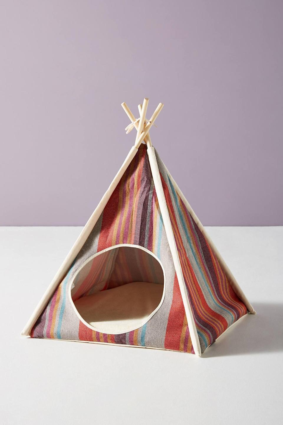 """<h3><strong>Cozy Pet Tent</strong></h3><p>Made from a pine-wood frame and covered in a chic-striped canvas, this cozy tent is read house cat to petite pup-naps with serious charm.</p><br><br><strong>Anthropologie</strong> Pet Play Tent, $88, available at <a href=""""https://www.anthropologie.com/shop/pet-play-tent?category=SEARCHRESULTS&color=060"""" rel=""""nofollow noopener"""" target=""""_blank"""" data-ylk=""""slk:Anthropologie"""" class=""""link rapid-noclick-resp"""">Anthropologie</a>"""