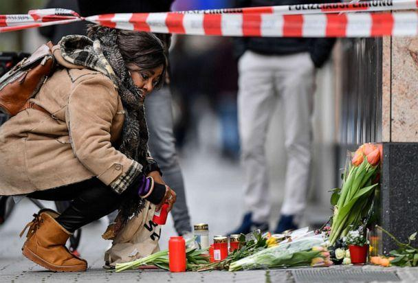 PHOTO: A woman sets a candle near the scene where several people were killed in Hanau, Germany, Feb. 20, 2020. (Martin Meissner/AP)