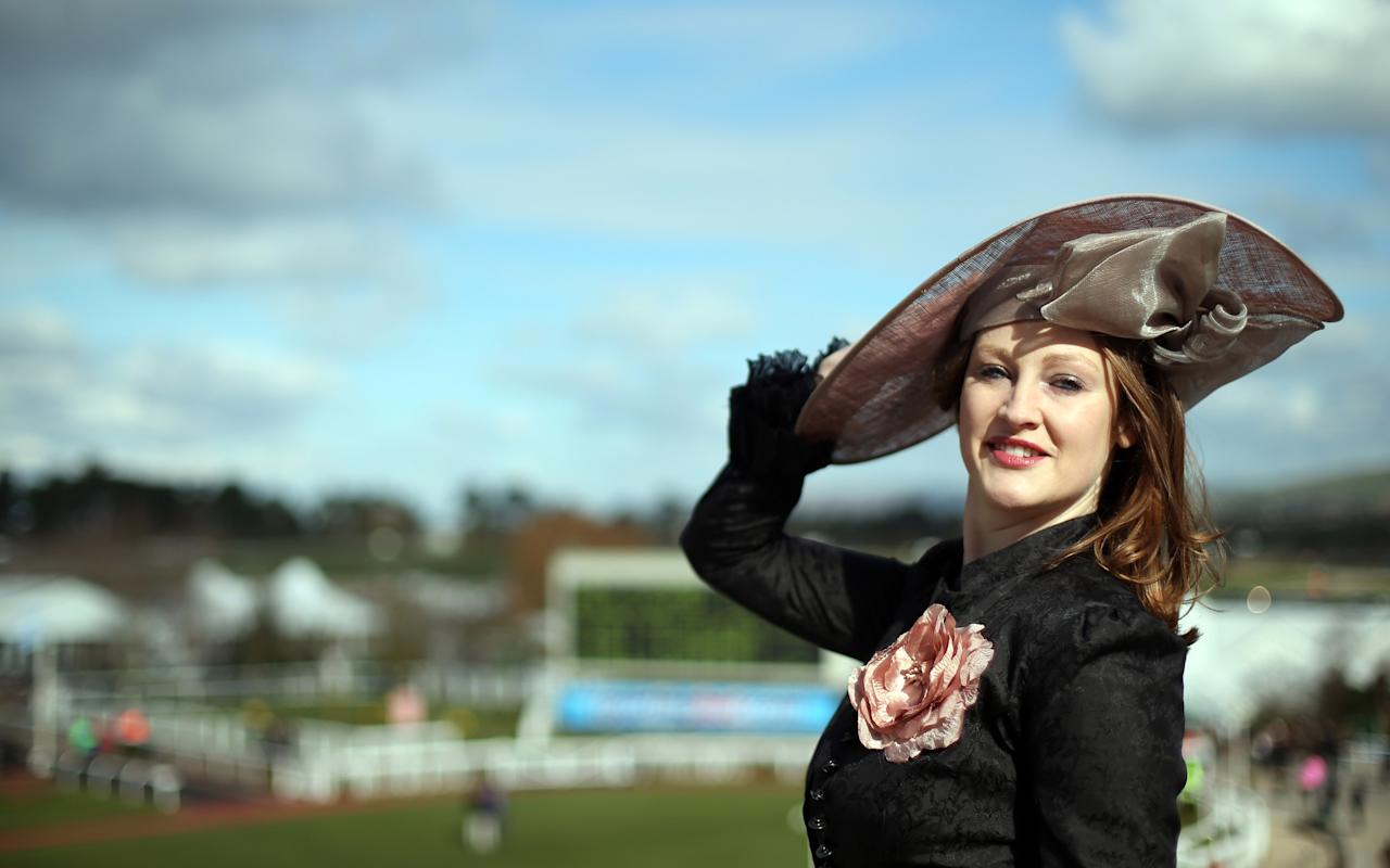 CHELTENHAM, ENGLAND - MARCH 13:  Camilla Bassett-Smith poses for a photograph as she arrives for Ladies Day at Cheltenham Racecourse on the second day of the Cheltenham Festival 2013 on March 13, 2013 in Cheltenham, England. Approximately 200,000 racing enthusiasts are expected at the four-day festival, which opened today and is seen by many as the highlight of the jump racing calendar.  (Photo by Matt Cardy/Getty Images)