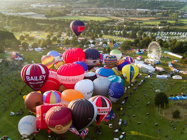 <p>The mass ascent of balloons at the Bristol International Balloon Fiesta. (Photo by Steve Parsons/PA Images via Getty Images) </p>
