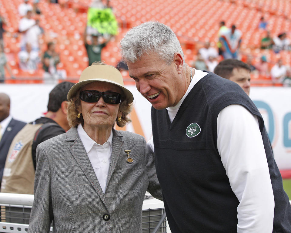 Former New York Jets head coach Rex Ryan stands with Betty Wold Johnson, the mother of the Jets' owners, before a game against the Dolphins in Miami in 2013.