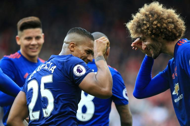 Manchester United's Antonio Valencia (2nd L) celebrates with teammate Marouane Fellaini after scoring a goal during their English Premier League match against Middlesbrough, at Riverside Stadium in Middlesbrough, on March 19, 2017