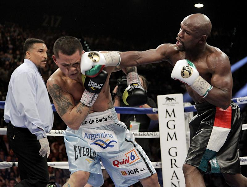 Floyd Mayweather Jr. (R) slams a right to the face of Marcos Maidana on May 3, 2014 at The MGM Grand, Las Vegas, the rematch is in September
