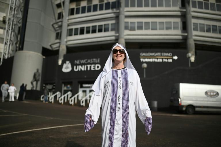 Newcastle fans have celebrated the takeover, depiste the controversy (AFP/Oli SCARFF)