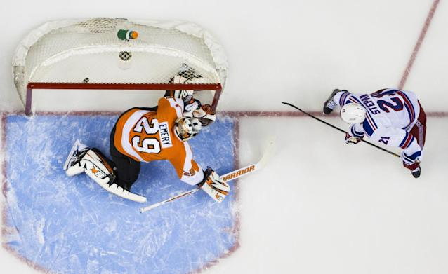 New York Rangers' Derek Stepan, right, gets the puck past Philadelphia Flyers' Ray Emery, left, for a goal during the first period in Game 3 of an NHL hockey first-round playoff series, Tuesday, April 22, 2014, in Philadelphia. (AP Photo/Chris Szagola)