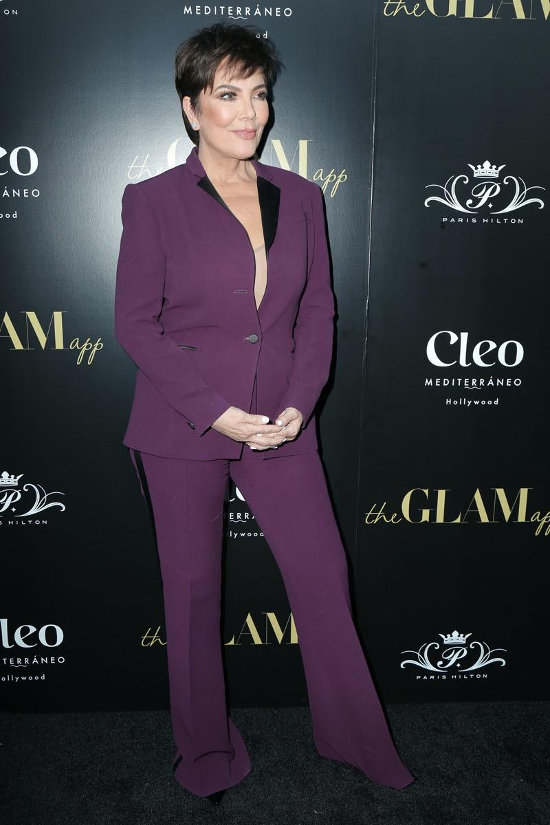 Kris Jenner wears a purple suit at the Glam App Celebration Event in 2019