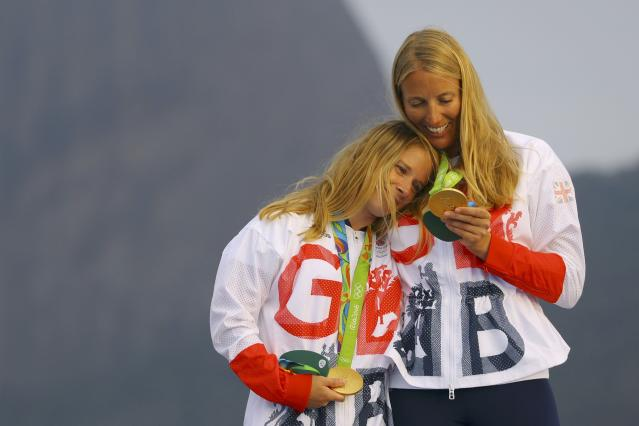 2016 Rio Olympics - Sailing - Victory Ceremony - Women's Two Person Dinghy - 470 - Victory Ceremony - Marina de Gloria - Rio de Janeiro, Brazil - 18/08/2016. Hannah Mills (GBR) of Britain and Saskia Clark (GBR) of Britain celebrate gold medal. REUTERS/Brian Snyder FOR EDITORIAL USE ONLY. NOT FOR SALE FOR MARKETING OR ADVERTISING CAMPAIGNS.