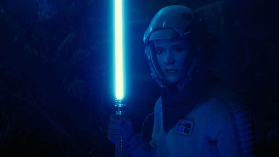Leia wields a lightsaber in a flashback scene during 'Star Wars: The Rise of Skywalker'. (Credit: Disney/Lucasfilm)
