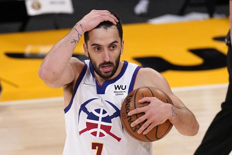 Denver Nuggets guard Facundo Campazzo reacts after being called for a foul during the second half of an NBA basketball game against the Los Angeles Lakers Monday, May 3, 2021, in Los Angeles. (AP Photo/Mark J. Terrill)