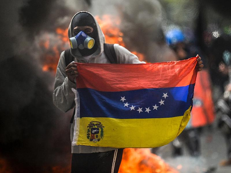 A demonstrator protests against the government of President Nicolas Maduro in Caracas on May 31, 2017