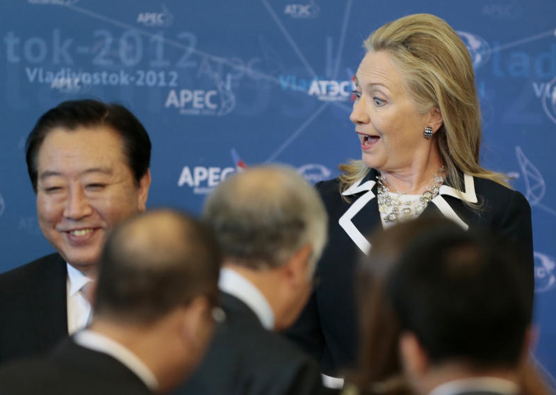 U.S. Secretary of State Hillary Rodham Clinton reacts as she meets fellow leaders for the group photo on the final day of the APEC summit in Vladivostok, Russia, Sunday, Sept. 9, 2012. (AP Photo/Mikhail Metzel)