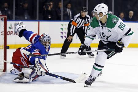 Dec 11, 2017; New York, NY, USA; Dallas Stars center Jason Spezza (90) scores the game winning goal past New York Rangers goalie Ondrej Pavelec (31) during a shootout at Madison Square Garden. Mandatory Credit: Adam Hunger-USA TODAY Sports