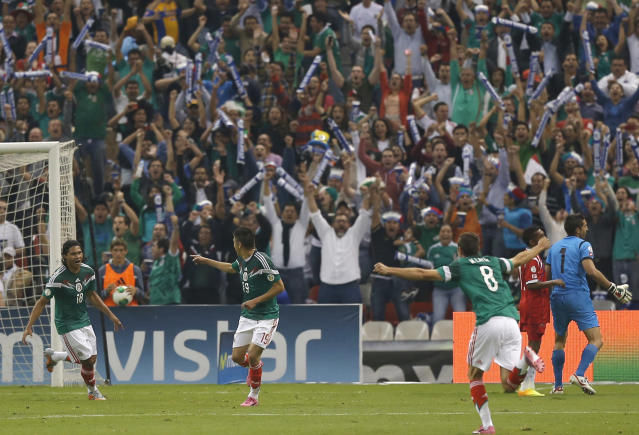 Mexico's Oribe Peralta, center, celebrates after scoring against Panama during at a 2014 World Cup qualifying match, in Mexico City, Friday, Oct. 11, 2013. (AP Photo/Eduardo Verdugo)