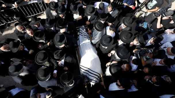PHOTO: Mourners carry the body of Rabbi Eliezer Goldberg, who died in the stampeded during religious celebrations at Mt. Meron in northern Israel, at his funeral in Jerusalem, April 30, 2021. (Ariel Schalit/AP)