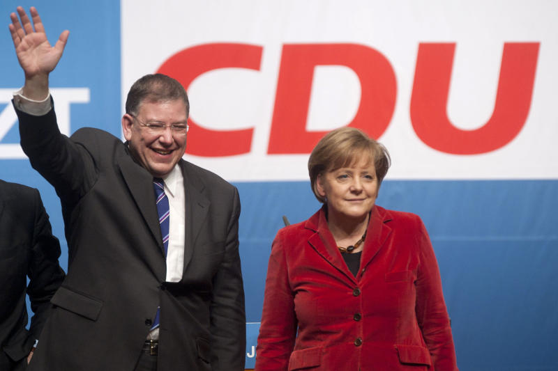Hamburg Mayor and top candidate for the local elections in Hamburg, Christoph Ahlhaus, left, and German Chancellor Angela Merkel attend an election campaign rally in Hamburg, northern Germany, Thursday, Feb 17, 2011. Germany is embarking on a monthslong string of electoral tests that looks set to start with a thrashing for Chancellor Angela Merkel's conservatives.  Merkel has just scrambled to replace Germany's central bank chief and her most popular minister faces embarrassing plagiarism allegations. Yet the betting is she will emerge from a bumpy ride with her grip on Europe's biggest economy still firm. (AP Photo/dapd, Nigel Treblin)