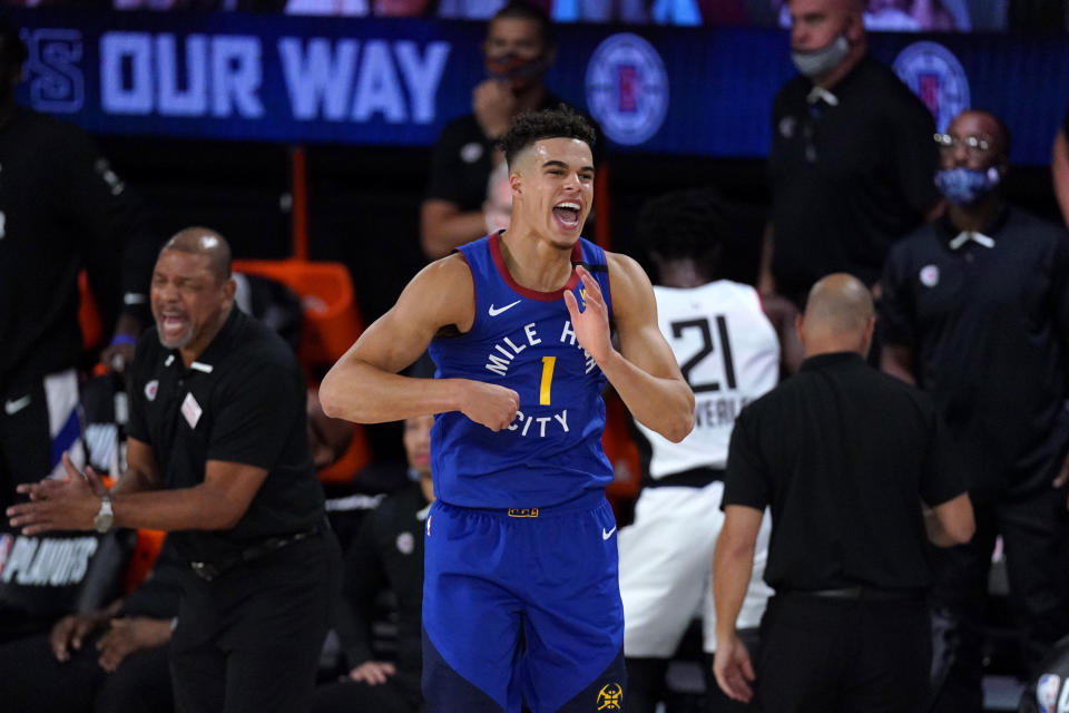 Denver Nuggets' Michael Porter Jr. reacts after a basket during the second half of an NBA conference semifinal playoff basketball game against the Los Angeles Clippers, Friday, Sept. 11, 2020, in Lake Buena Vista, Fla. (AP Photo/Mark J. Terrill)