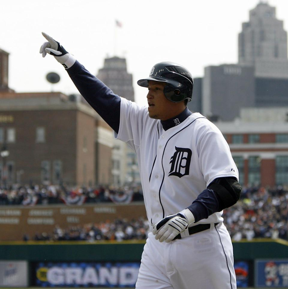 Detroit Tigers slugger Miguel Cabrera points to the crowd after his grand slam for a 7-0 Tigers lead with 2 outs in the fourth inning against the Texas Rangers  in Detroit on Friday, April 10, 2009.