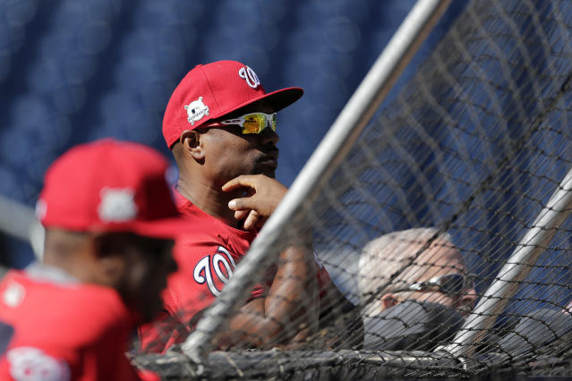 "<a class=""link rapid-noclick-resp"" href=""/mlb/teams/was/"" data-ylk=""slk:Washington Nationals"">Washington Nationals</a>' assistant hitting coach Jacque Jones (center) has been suspended without pay pending a legal matter. (AP)"