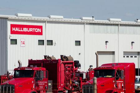 FILE PHOTO: Idle oil production equipment is seen in a Halliburton yard in Williston