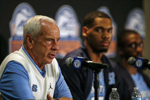 North Carolina coach Roy Williams, left, answers a question during the Atlantic Coast Conference NCAA college basketball media day in Charlotte, N.C., Tuesday, Oct. 8, 2019. (AP Photo/Nell Redmond)