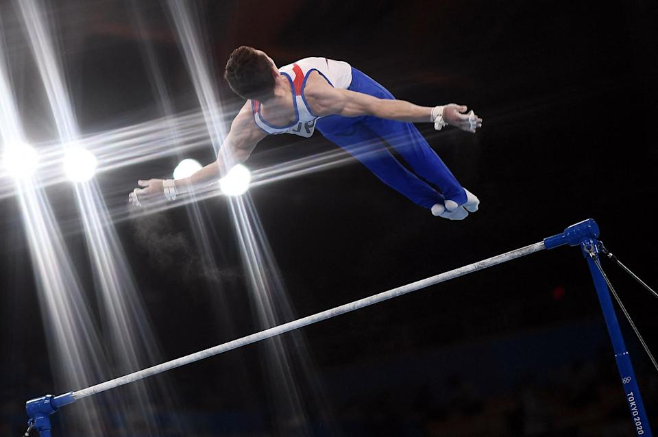 <p>Russia's David Belyavskiy competes in the horizontal bars event of the artistic gymnastics men's team final on July 26.</p>