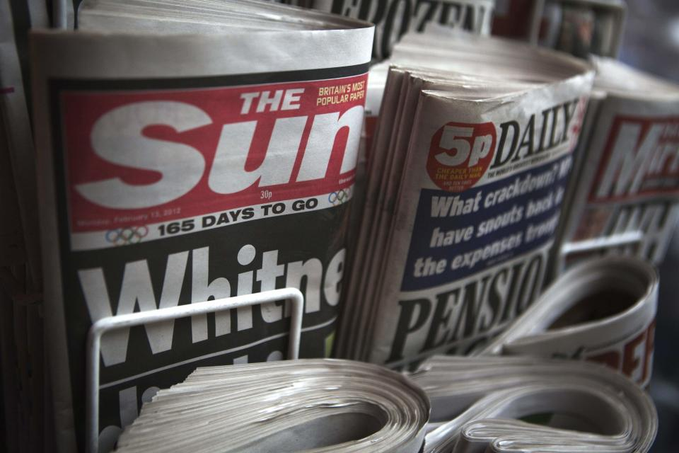 Copies of The Sun newspaper are displayed at a kiosk in London February 13, 2012.  Rupert Murdoch is under pressure over his Sun tabloid after the arrests of several senior staff in a corruption probe, but whistleblowers inside his media empire may pose more of a threat than the public outrage that forced the closure of its sister paper, News of the World weekly, after allegations of phone hacking.  REUTERS/Finbarr O'Reilly (BRITAIN - Tags: MEDIA CRIME LAW SOCIETY)