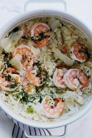 """<p>This recipe cheats the usual way you make risotto. You don't have to bother with stirring; instead, bake the rice in the oven, and add the prawns and cheese at the very end.</p><p>Get the <a href=""""https://www.delish.com/uk/cooking/recipes/a30241944/baked-shrimp-risotto/"""" rel=""""nofollow noopener"""" target=""""_blank"""" data-ylk=""""slk:Baked Prawn Risotto"""" class=""""link rapid-noclick-resp"""">Baked Prawn Risotto</a> recipe. </p>"""