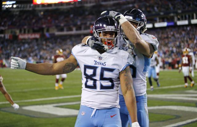 Tennessee Titans tight end MyCole Pruitt (85) celebrates with tight end Anthony Firkser after Pruitt scored a touchdown on a 2-yard pass reception against the Washington Redskins in the second half of an NFL football game Saturday, Dec. 22, 2018, in Nashville, Tenn. (AP Photo/James Kenney)