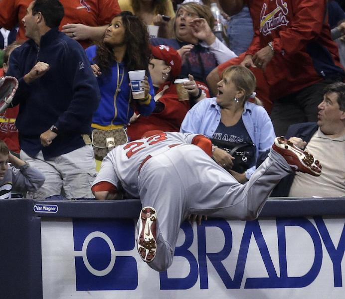 St. Louis Cardinals third baseman David Freese can't come up with a foul ball hit by Milwaukee Brewers' Scooter Gennett during the third inning of a baseball game Friday, Sept. 20, 2013, in Milwaukee. (AP Photo/Morry Gash)