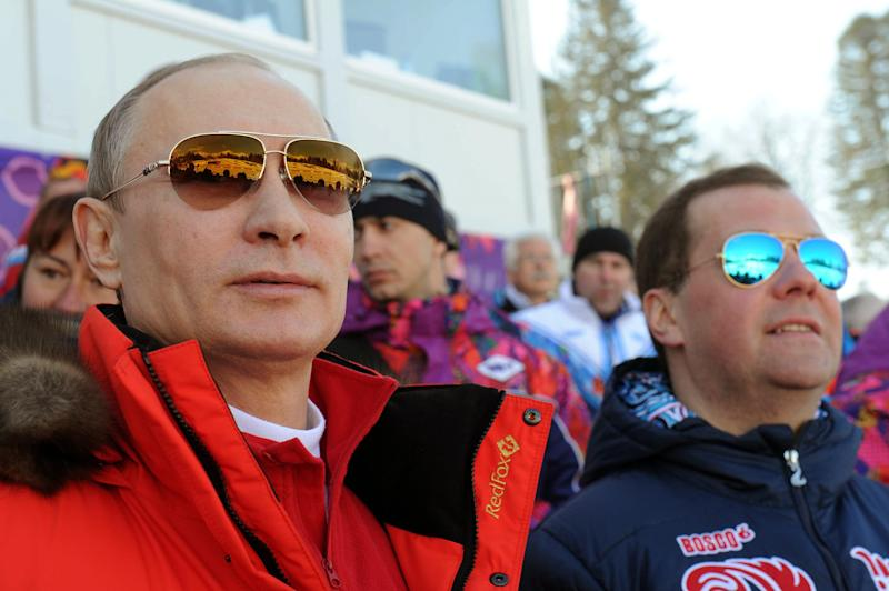 FILE - In this Feb. 16, 2014 file photo, Russian President Vladimir Putin, left, and Premier Dmitry Medvedev watch the men's 4x10 km cross-country relay at the 2014 Winter Olympics in Krasnaya Polyana, Russia. Competitors at the Olympics get nervous knowing that the eyes of the world will be on them for a few minutes. For Putin, that scrutiny extends for the entire 17 days of the games. (AP Photo/RIA-Novosti, Mikhail Klimentyev, Presidential Press Service)
