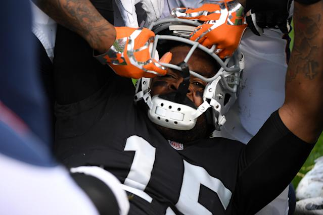 <p>Michael Crabtree #15 of the Oakland Raiders has his helmet pulled off during a fight with Aqib Talib #21 of the Denver Broncos in their NFL game at Oakland-Alameda County Coliseum on November 26, 2017 in Oakland, California. Both players were ejected from the game. (Photo by Robert Reiners/Getty Images) </p>