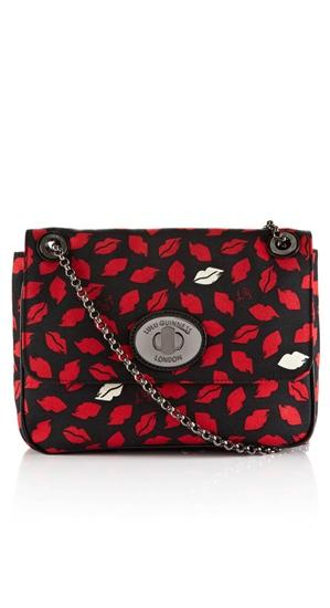 "<b>Lulu Guinness for Cocosa:</b><a target=""_blank"" href=""https://www.cocosa.com/Sale/?sid=16572&catid=Women#""> Large Annabelle lip print bag</a> £125 Was £275"