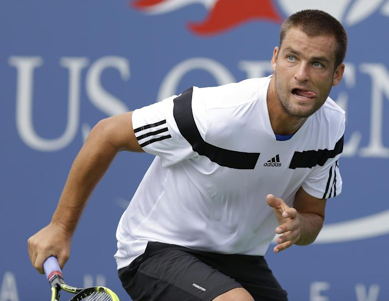 Mikhail Youzhny, of Russia, chases down a ball to return to Lleyton Hewitt, of Australia, during the quarterfinals of the 2013 U.S. Open tennis tournament, Tuesday, Sept. 3, 2013, in New York. (AP Photo/Kathy Willens)