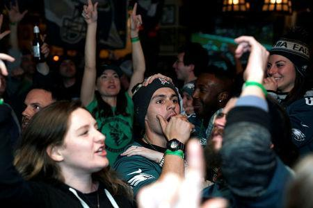 Football fans react as they watch Super Bowl LII between the New England Patriots and the Philadelphia Eagles at the city's oldest tavern, McGillin's Olde Ale House in Philadelphia, Pennsylvania, U.S. February 4, 2018. REUTERS/Jessica Kourkounis