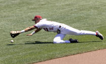 North Carolina State's Adam Crampton (10) dives in vain for a single hit by Stanford's Tommy Troy (12) in the fourth inning in the opening baseball game of the College World Series, Saturday, June 19, 2021, at TD Ameritrade Park in Omaha, Neb. (AP Photo/Rebecca S. Gratz)