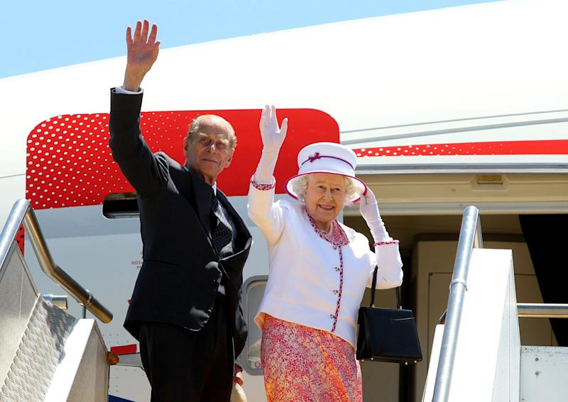 Britain's Queen Elizabeth II (R) and Prince Philip wave goodbye as they board their flight at Perth International Airport following their 10-day visit to Australia on October 29, 2011. The queen wrapped up an immensely successful tour of Australia in which tens of thousands flocked to catch a glimpse of their monarch, perhaps for the last time. AFP PHOTO / POOL / Lincoln Baker (Photo credit should read LINCOLN BAKER/AFP via Getty Images)