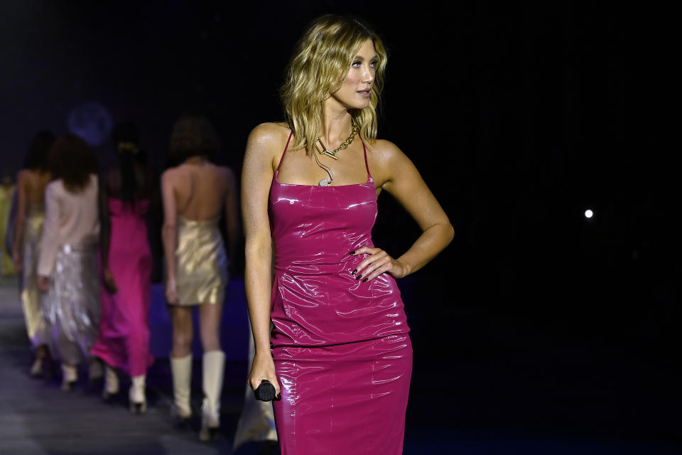 Singer Delta Goodrem wears a magenta pink latex dress while performing as models walk the runway during the Manning Cartell show during Afterpay Australian Fashion Week 2021 Resort '22 Collections at Carriageworks on June 03, 2021 in Sydney, Australia. (Photo by Stefan Gosatti/Getty Images)