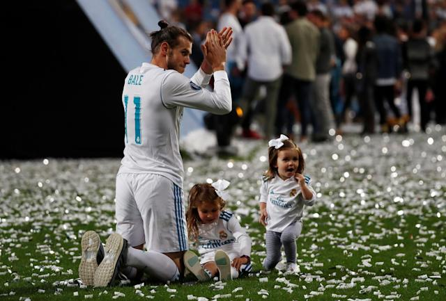 Soccer Football - Real Madrid celebrate winning the Champions League Final - Santiago Bernabeu, Madrid, Spain - May 27, 2018 Real Madrid's Gareth Bale celebrates during the victory celebrations REUTERS/Javier Barbancho