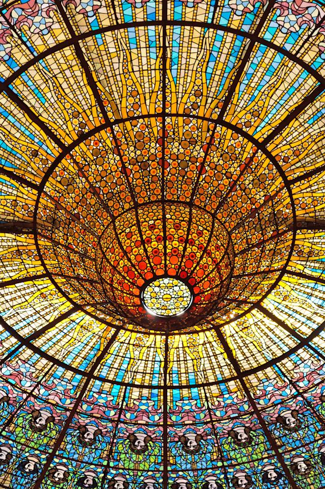 Built between 1905 and 1908, architect Lluís Domènech i Montaner's Catalan Art Nouveau masterpiece is listed as a UNESCO World Heritage Site and boasts a monumental stained-glass-and-mosaic ceiling.