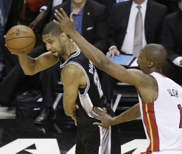 San Antonio Spurs' Tim Duncan (21) and the Miami Heat's Chris Bosh (1) work during the first half in Game 7 of the NBA basketball championships, Thursday, June 20, 2013, in Miami. (AP Photo/Wilfredo Lee)